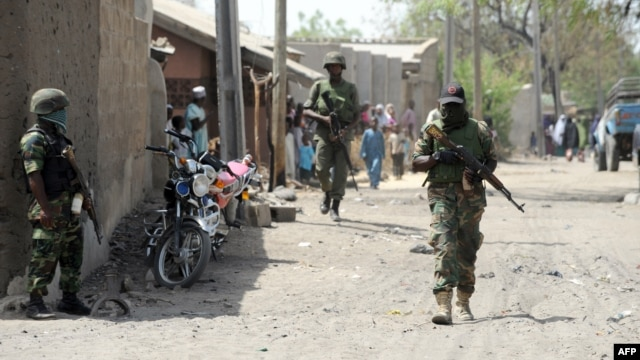 Nigerian soldiers are seen patrolling a town in the north-eastern state of Borno in this April 30, 2013, file photo.