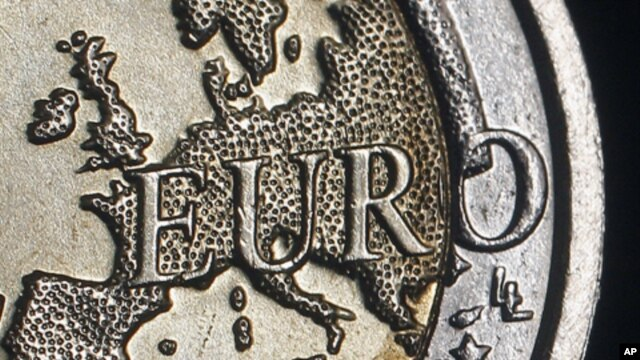 The map of Europe is featured on the face of a two Euro coin seen in this photo illustration taken in Rome, (December 2011 file photo)