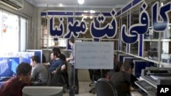 FILE - Iranians surf the Internet at a cafe in Tehran, Iran, Tuesday, Sept, 17, 2013.