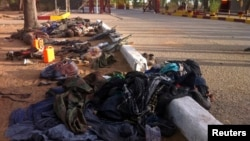 Recovered weapons, personal items and bodies Nigerian Islamist sect Boko Haram in Bama, Maiduguri, Borno State, May 7, 2013.