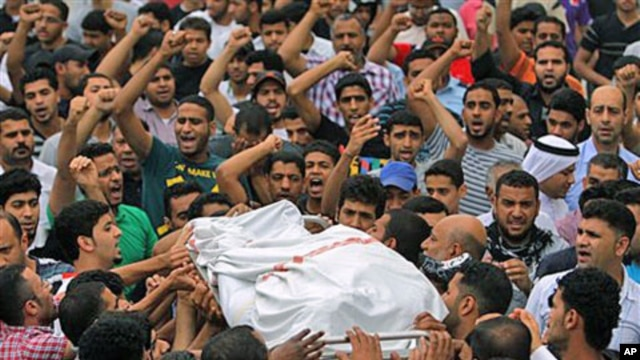 Mourners chant anti-government slogans as they carry the body of Ali Isa Saqer, 31, to be washed for burial in his village of Sehla, Bahrain, April 10, 2011, after he died in police custody in the past week