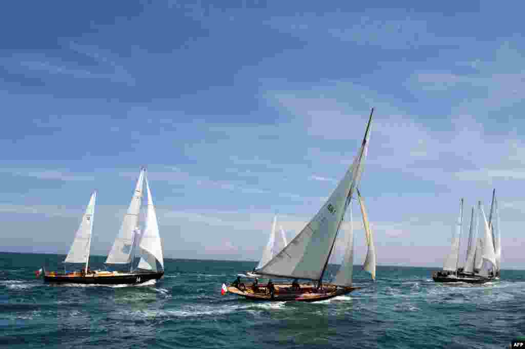 Pen Duick ocean racing yachts sail off the coast of Saint-Quay-Portrieux, western France during a trip at sea from Roscoff to Saint-Quay-Portrieux.