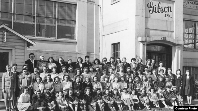 This 1944 wartime staff portrait, taken at the Gibson guitar factory in Michigan, piqued author John Thomas' curiosity about the women's role in making the iconic instruments. (Courtesy of John Thomas)