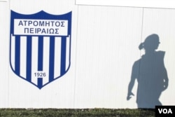A player walks past the changing rooms at the training grounds. Organization Earth has helped the team secure a field to play on, and intends to help cover the costs of going to play Greek teams, Nov. 11, 2016. (J. Owens/VOA)