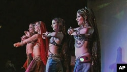 Some of the troupe of 'Belly Dancing Super Stars' give one of their unique performances as they tour the world promoting this form of the ancient dance, Nov 2010