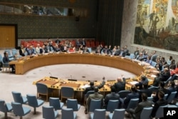 FILE - The United Nations Security Council votes on a new sanctions resolution that would increase economic pressure on North Korea to return to negotiations on its missile program at U.N. headquarters, Aug. 5, 2017.
