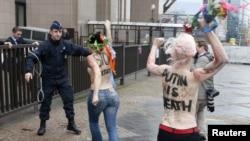 Femen members protest Putin's human rights record, European Union Council building, Brussels, Dec. 21, 2012.