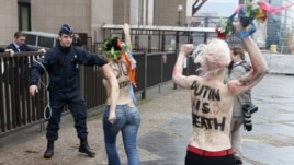 Femen members protest Putin's human rights record, European Union Council building, Brussels, Dec. 21, 2012.
