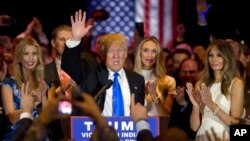 Republican presidential candidate Donald Trump is joined by his wife Melania, right, daughter Ivanka, left, as he speaks during a primary night news conference, Tuesday, May 3, 2016, in New York. (AP Photo/Mary Altaffer)