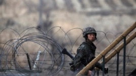 A South Korean soldier walks up the stairs at an observation post, near the demilitarized zone that separates the two Koreas, in Paju, north of Seoul, March 12, 2013.