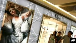 A family walks out of a Dior store in Beijing, China, in this 2007 file photo.