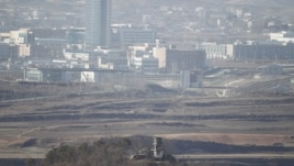 A North Korean guard post (bottom, C) is pictured from the truce village of Panmunjom in the demilitarized zone separating the two Koreas in Paju, north of Seoul, as the Kaesong inter-Korean industrial complex is seen in the background. (2011 File)
