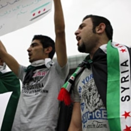 Syrian Kurds wearing Syrian opposition flags chant participate in a sit-in in front of UN headquarters in Beirut, Lebanon, in solidarity with anti-government protesters in Syria, April 29, 2012.