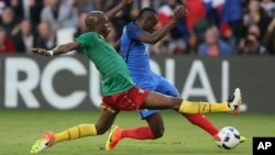 FILE - France's Blaise Matuidi, right, is tackled by Cameroon's Allan Nyom during a friendly soccer match between France and Cameroon at the La Beaujoire Stadium in Nantes, France, May 30, 2016.