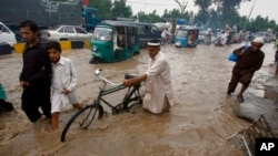 Disasters like this flood in Peshawar, Pakistan, hurt people and their livlihoods.