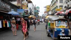 Tourists walk along Khao San road in Bangkok. Thai authorities have arrested a Lebanese suspect after being warned by Israel of a possible attack in Bangkok.
