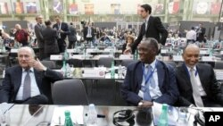 FIFA president Sepp Blatter, left, and Mohamed bin Hammam of Qatar, president of the Asian Football Confederation, right, take a break as Confederation of African Football President Issa Hayatou, center, looks on, March 22, 2011 (file photo).