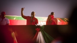 President John Dramani Mahama speaks to ruling party supporters at his final campaign rally ahead of Friday's presidential election, in Accra, December 5, 2012.