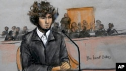 A courtroom sketch depicts Boston Marathon bombing suspect Dzhokhar Tsarnaev sitting in federal court in Boston, Massachusetts, Dec. 18, 2014, for a final hearing before his trial begins in January.