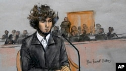 FILE - A courtroom sketch depicts Boston Marathon bombing suspect Dzhokhar Tsarnaev sitting in federal court in Boston, Massachusetts, Dec. 18, 2014.