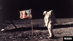 """Astronaut Edwin E. """"Buzz"""" Aldrin Jr. poses for a photograph beside the U.S. flag deployed on the moon during the Apollo 11 mission on July 20, 1969. (AP Photo/NASA/Neil A. Armstrong)"""