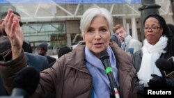 FILE - Jill Stein, 2016 Green Party candidate for U.S. president, holds a rally and protest against stopping the recount of election ballots at Cobo Center in Detroit, Michigan, Dec.10, 2016.