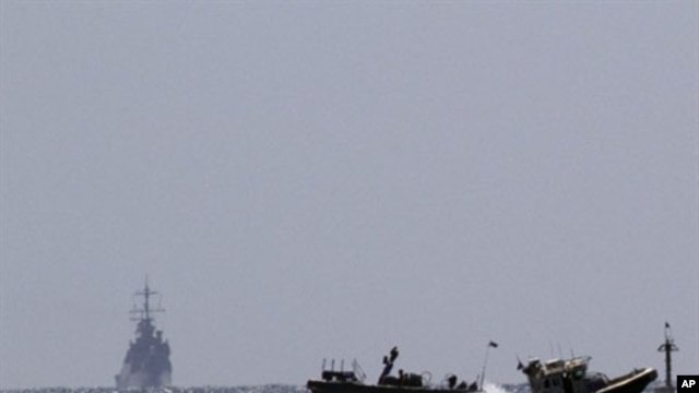 Israeli naval vessels (L) arrive at the port of Ashdod in southern Israel, 05 Jun 2010