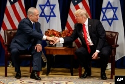 FILE - President Donald Trump shakes hands with Israeli Prime Minister Benjamin Netanyahu during a meeting at the Palace Hotel during the United Nations General Assembly in New York, Sept. 18, 2017.