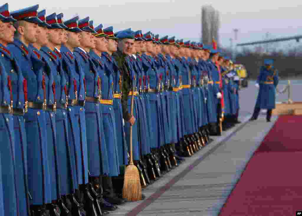 Members of the Serbian Honor guard prepare for the welcoming ceremony for Hungary's Prime Minister Viktor Orban, at the Constantine the Great Airport, in the town of Nis, Serbia.