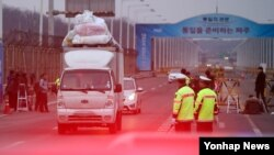 A truck passes the bridge between North and South Korea after leaving the Kaesong Industrial Complex. Tensions have increased as the North has expelled South Koreans and seized assets in response to the South's suspension of the project.