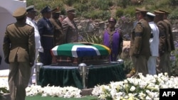 A screengrab taken from the South African Broadcasting Corporation live feed shows members of the South African armed forces standing around the coffin of late former President Nelson Mandela before it is lowered into the grave during his funeral in Qunu, Dec. 15, 2013.