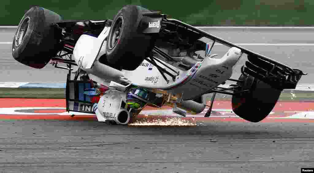 Williams Formula One driver Felipe Massa of Brazil crashes with his car in the first corner after the start of the German F1 Grand Prix at the Hockenheim racing circui.