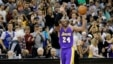 FILE - Los Angeles Lakers guard Kobe Bryant (24) holds up the game ball and acknowledges the crowd during an NBA basketball game against the Minnesota Timberwolves after passing Michael Jordan on the NBA all-time scoring list, in Minneapolis, Dec. 14, 2014.