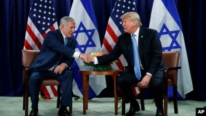 9da4b07a41e626 FILE - President Donald Trump shakes hands with Israeli Prime Minister  Benjamin Netanyahu at the United