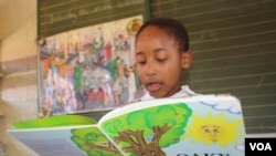 Karobo Mokhere,8, reads to her class at Thabo-Tshehlo in Soweto. Just a few months ago, she struggled to read a sentence. (D. Taylor/VOA)