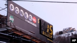 A billboard advertising the record $1.5 billion U.S. Powerball jackpot is seen in downtown Pittsburgh, Pennsylvania, Jan. 12, 2016.