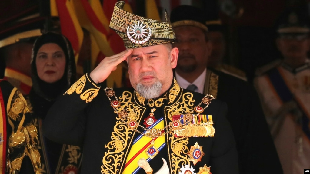 Malaysia King Sultan Muhammad V salutes during the national anthem at the opening of the 14th parliament session at the Parliament house in Kuala Lumpur, July 17, 2018.