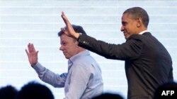Слева направо: Хуан Мануэль Сантос, Барак Обама.