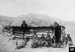 Traditional houses called hogans, are made of logs and covered with earth or adobe, to help keep out both the raging heat and bitter cold of the Navajos' high-desert homeland.