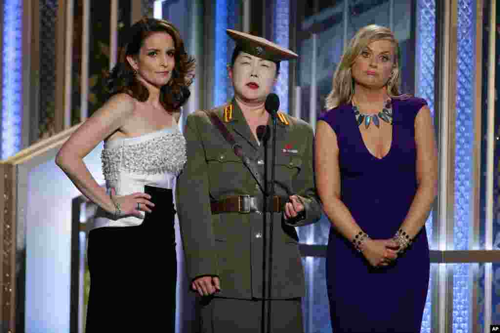 In this image released by NBC, Tiny Fey (from left), Margaret Cho and Amy Poehler speak at the 72nd Annual Golden Globe Awards at the Beverly Hilton Hotel in Beverly Hills, California, Jan. 11, 2015.