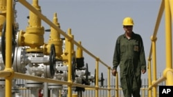 An Iranian oil technician makes his way at the oil separator facilities in Azadegan oil field in Iran. Eleven countries have been granted an exception from U.S. sanctions aimed at cutting funding for Iranian oil exports.