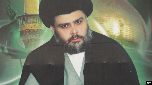 A giant portrait of Iraqi Shiite cleric Moqtada al-Sadr is displayed in Baghdad's Sadr City district, Feb. 16, 2014.