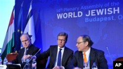From left: WJC President Ronald S. Lauder, German Foreign Minister Guido Westerwelle, President of Central Council of Jews in Germany Dieter Graumann, Budapest, May 6, 2013.