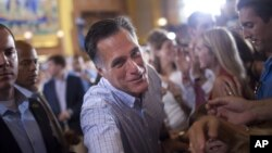 Republican presidential candidate, former Massachusetts Gov. Mitt Romney shakes hands during a campaign rally, Saturday, Sept. 1, 2012, in Cincinnati, Ohio.