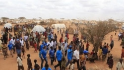 UN High Commissioner for Refugees Antonio Guterres, center right, in white shirt, walks with UNHCR staff and Somali refugees during a visit to Dagahaley Camp, near Dadaab, Kenya.