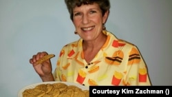 Author Kim Zachman shows the peanut butter cookies from her book There's No Ham in Hamburgers.