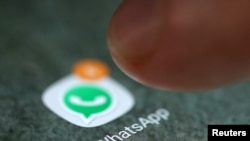 FILE - The WhatsApp icon is seen on a smartphone.