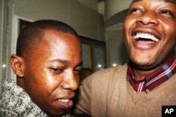 One of East Africa's most vocal gay rights activists, Denis Nzioka (right), with a friend, in Nairobi