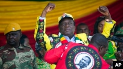 Zimbabwean President Emmerson Mnangagwa addresses the final rally of his campaign at the stadium in Harare, Zimbabwe, Saturday July 28, 2018.