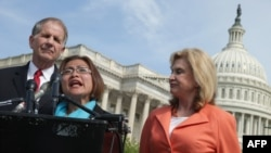 Human trafficking survivor Shandra Woworuntu (C) speaks during a news conference with Rep. Ted Poe (L) and Rep. Carolyn Maloney outside the U.S. Capitol May 20, 2014.